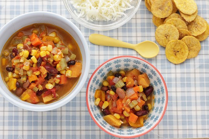 veggie chili with beans in bowls on tablecloth
