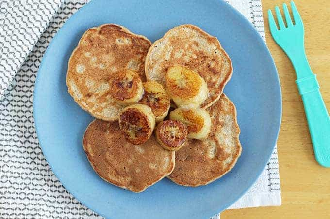 banana oatmeal pancakes on blue plate
