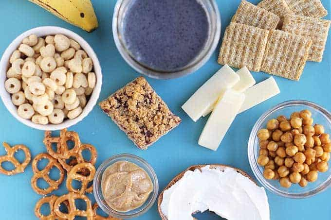 healthy pregnancy snacks including pretzels and nut butter, breakfast bars, roasted chickpeas