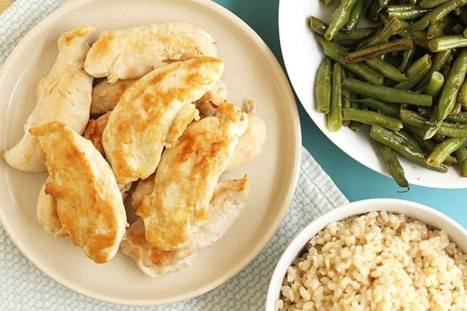chicken tenders, brown rice, and green beans in bowls