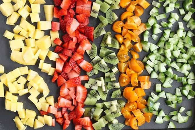 chopped fruit for salsa on cutting board