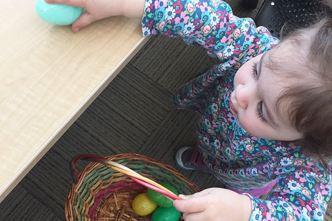 toddler easter egg hunt with plastic eggs