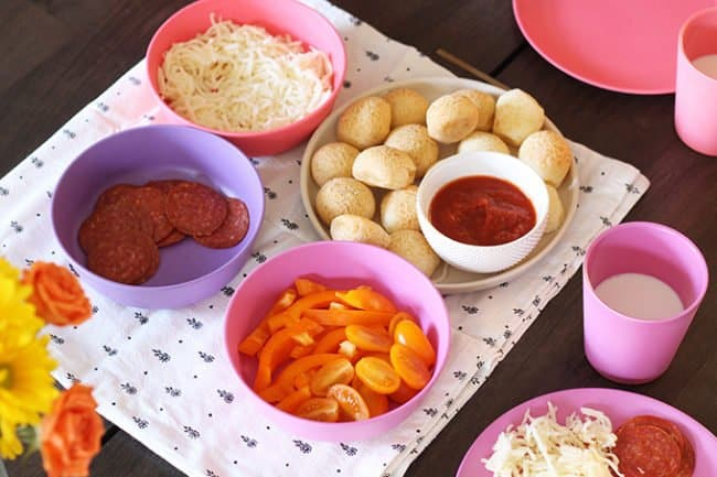 kids pizza party with toppings in pink bowls