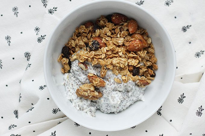 chia pudding with granola in white bowl