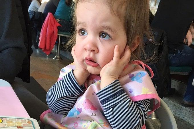 Toddler in restaurant highchair