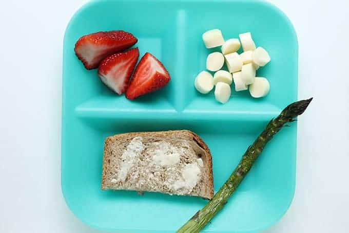 blue toddler plate with asparagus and bread