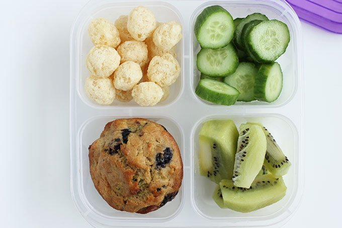packed lunch with muffin, cucumber, kiwi