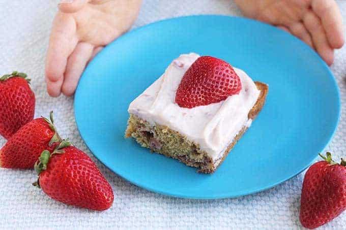 slice of strawberry cake on blue plate