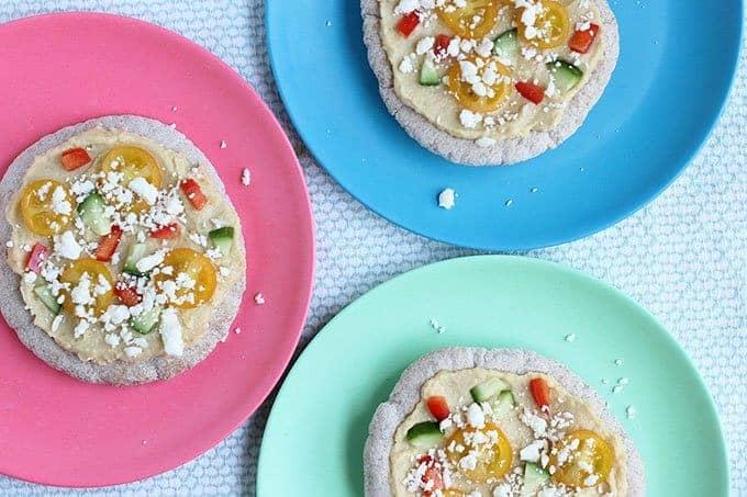 3 pita pizzas on colorful plates