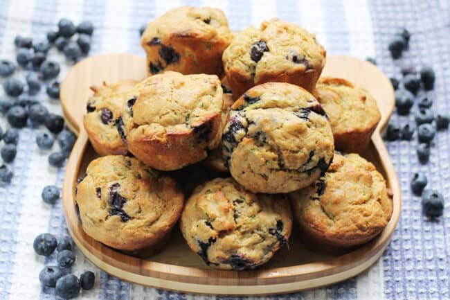 blueberry-zucchini-muffins-on-wooden-plate