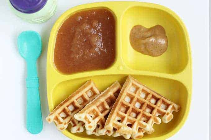 waffles and applesauce on yellow plate