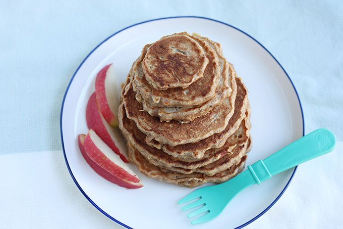 healthy apple pancakes on white plate