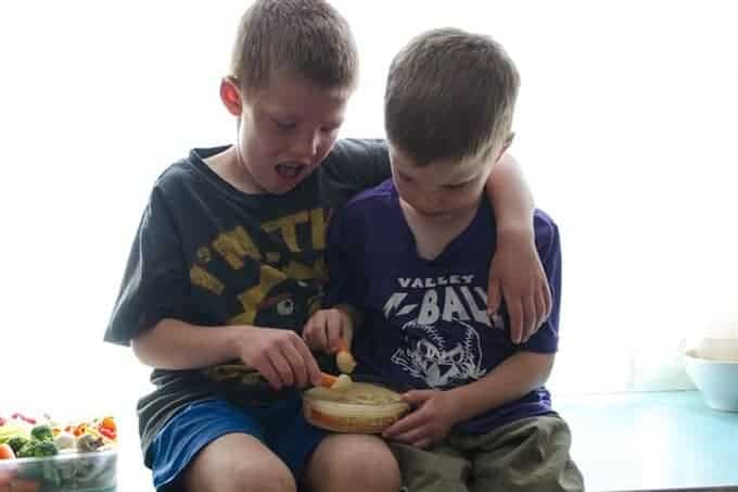 boys eating veggies
