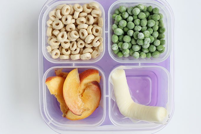 kids bento box for kindergarten with cereal, peas, cheese