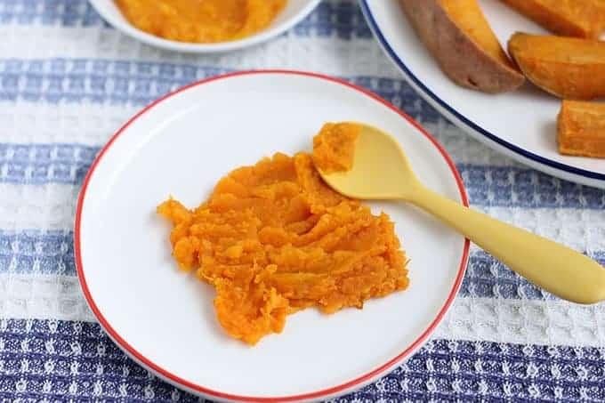 mashed roasted sweet potato on white kids plate