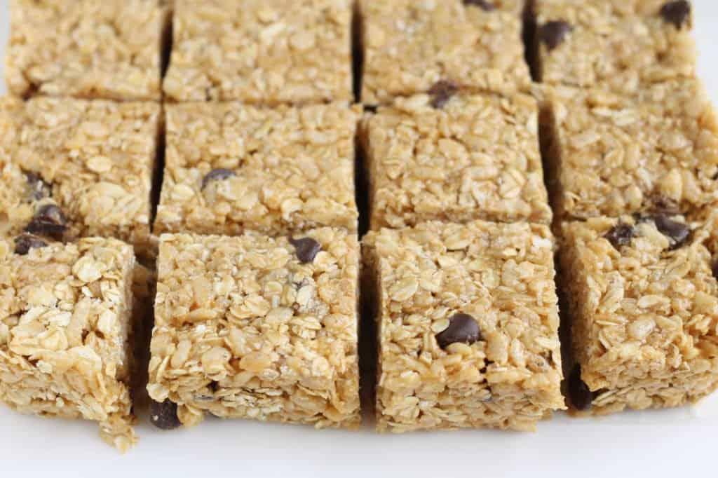 close up of no bake granola bars on cutting board