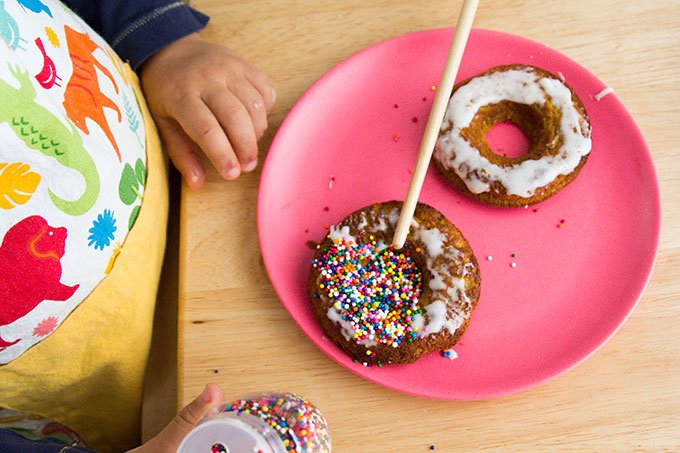 kids with donuts on pink plate