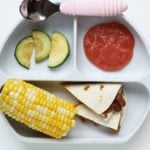 cut up vegetarian quesadillas for kids on plate