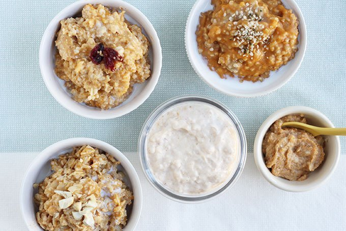 pumpkin oatmeal 5 different ways in white bowls