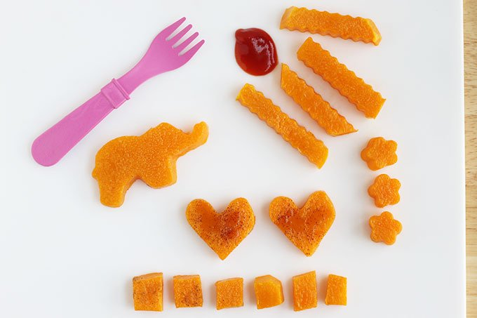 roasted butternut squash shapes and fries on cutting board