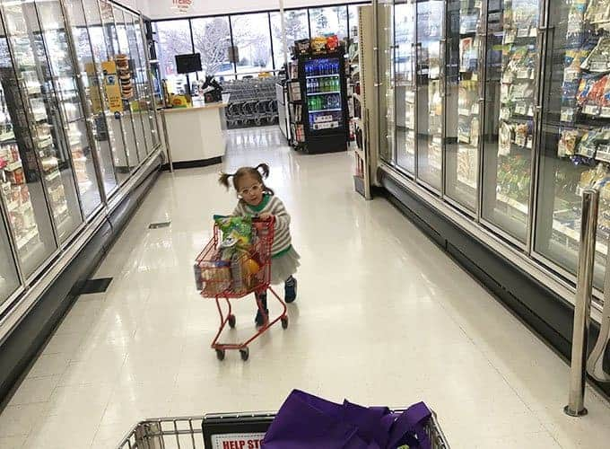toddler with shopping cart