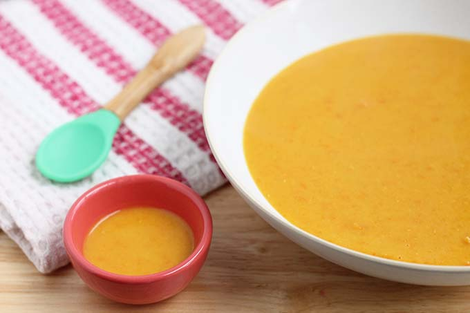 two bowls of red lentil soup for a family