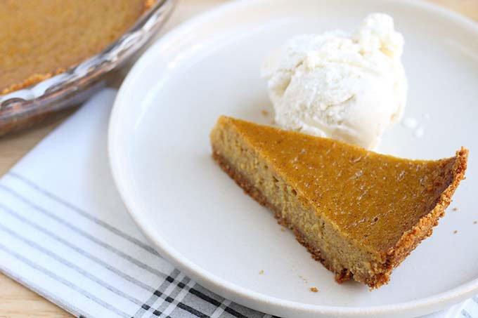 slice of butternut squash pie with ice cream