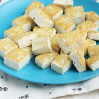 sesame tofu on blue kids plate