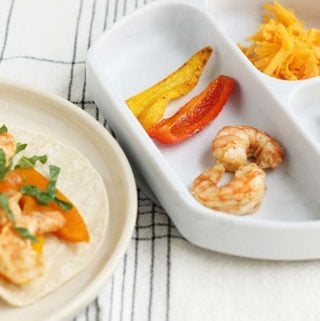 shrimp tacos for kids and parents on plates