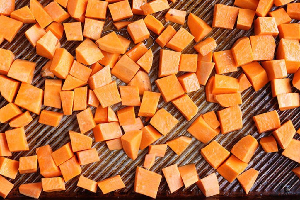 cut sweet potato on sheet pan