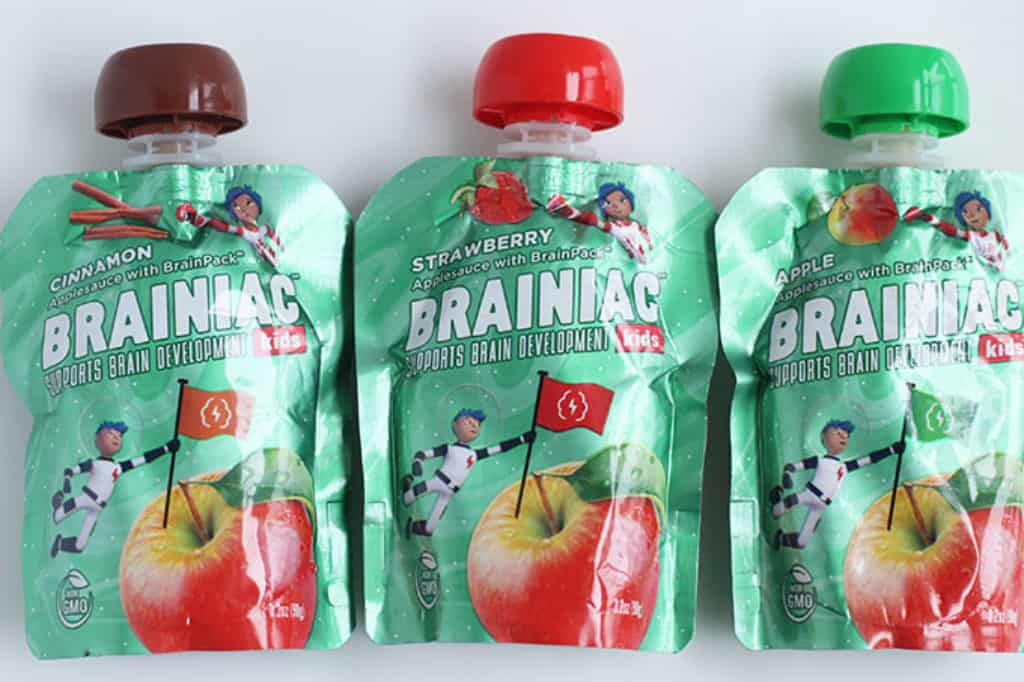 brainiac applesauce pouches on white cutting board