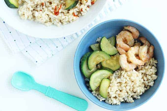 teriyaki shrimp and zucchini in blue bowl with rice