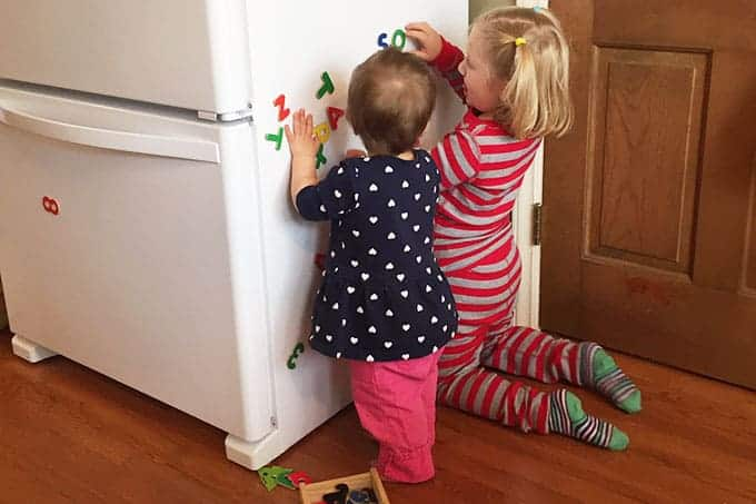 kids with fridge magnets