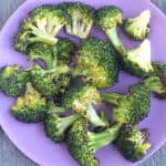 roasted broccoli on purple plate