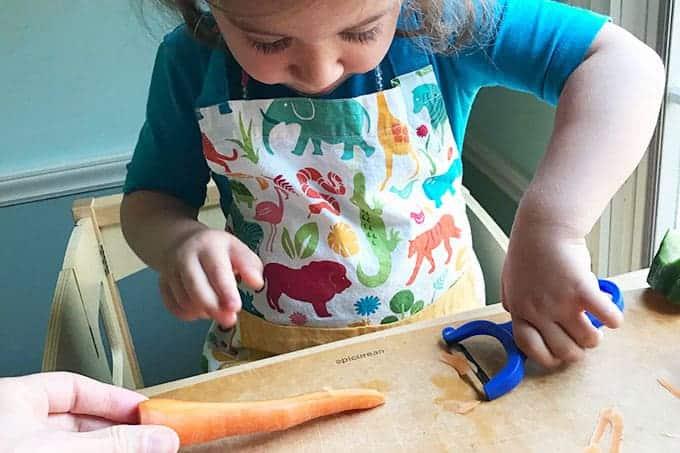 toddler-peeling-carrots