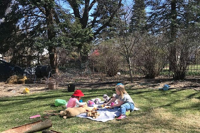 girls-having-picnic-with-stuffed-animals