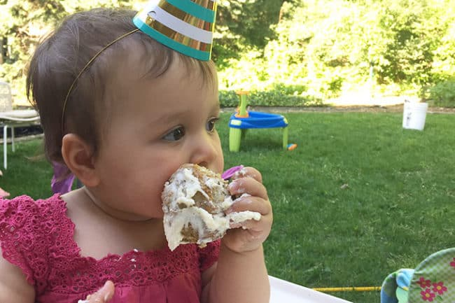 toddler-eating-first-birthday-cupcake