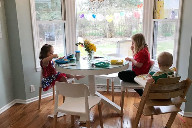 kids-eating-at-white-table