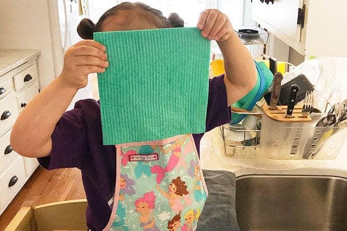 toddler with swedish dishcloth