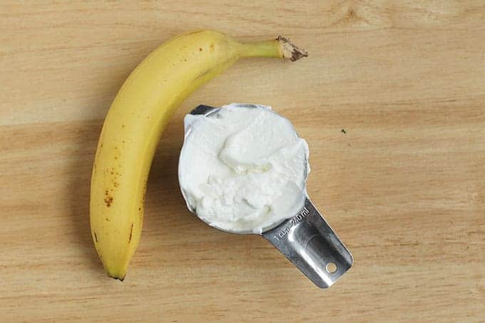 banana-and-yogurt-on-cutting-board