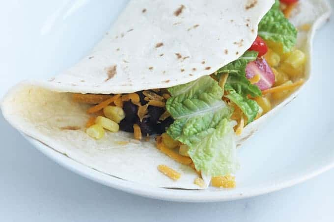 bean-and-corn-taco-on-white-plate