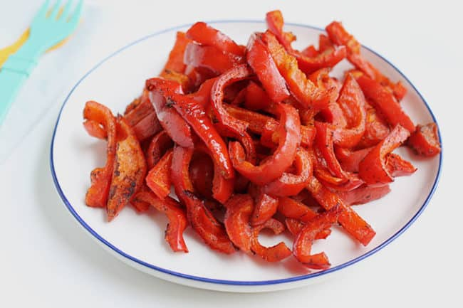 roasted-red-peppers-on-white-plate