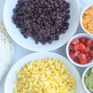 taco-buffet-ingredients-in-white-plates