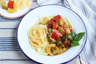 ratatouille with pasta in white bowl