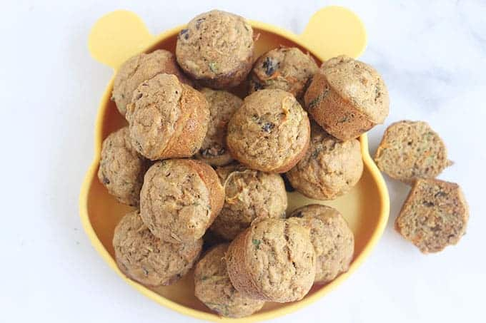 zucchini-carrot-muffins-on-yellow-plate
