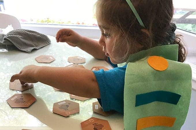 child-doing-bug-matching-game