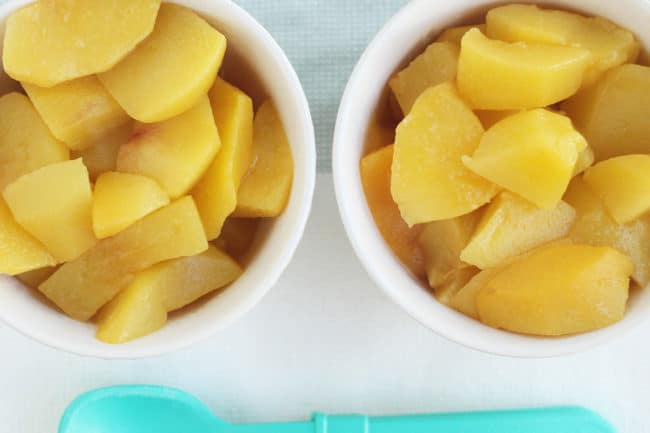 stewed peaches in two white bowls