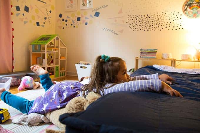 toddler-in-room-with-Hape-dollhouse