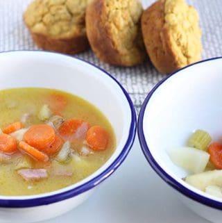 potato ham soup in white bowls
