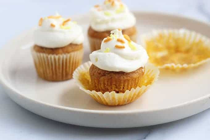 pumpkin-cupcakes-with-liners-on-plate